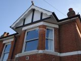 Concave decorative fascia with new Replica Wood mock tudor beams